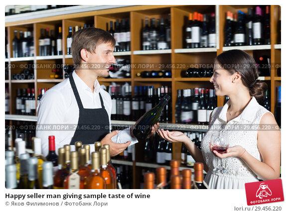 Купить «Happy seller man giving sample taste of wine», фото № 29456220, снято 28 марта 2020 г. (c) Яков Филимонов / Фотобанк Лори