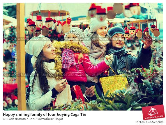 Купить «Happy smiling family of four buying Caga Tio», фото № 28576904, снято 25 июня 2018 г. (c) Яков Филимонов / Фотобанк Лори