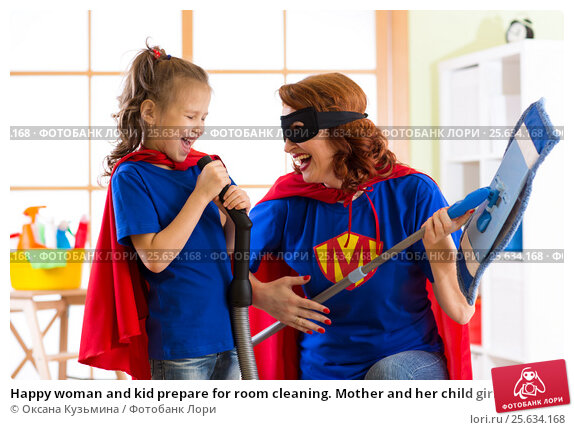 Happy woman and kid prepare for room cleaning. Mother and her child girl playing together. Family in Superhero costumes., фото № 25634168, снято 26 февраля 2017 г. (c) Оксана Кузьмина / Фотобанк Лори