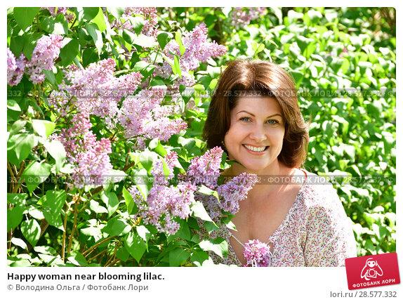 Купить «Happy woman near blooming lilac.», фото № 28577332, снято 16 мая 2018 г. (c) Володина Ольга / Фотобанк Лори