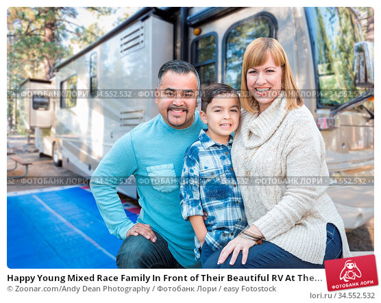 Happy Young Mixed Race Family In Front of Their Beautiful RV At The... Стоковое фото, фотограф Zoonar.com/Andy Dean Photography / easy Fotostock / Фотобанк Лори