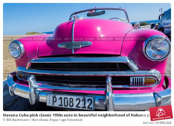 Купить «Havana Cuba pink classic 1950s auto in beautiful neighborhood of Habana parked.», фото № 14900024, снято 19 июня 2018 г. (c) age Fotostock / Фотобанк Лори