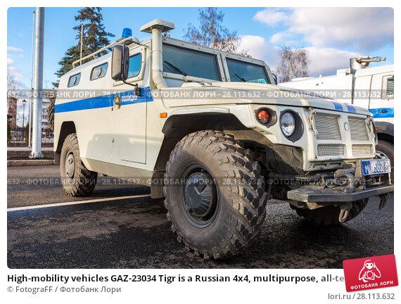 Купить «High-mobility vehicles GAZ-23034 Tigr is a Russian 4x4, multipurpose, all-terrain police mobility vehicle», фото № 28113632, снято 16 ноября 2017 г. (c) FotograFF / Фотобанк Лори