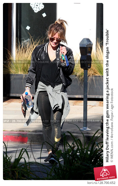 Купить «Hilary Duff leaving the gym wearing a jacket with the slogan 'Trouble' Featuring: Hilary Duff Where: Los Angeles, California, United States When: 28 Dec 2016 Credit: WENN.com», фото № 28700652, снято 28 декабря 2016 г. (c) age Fotostock / Фотобанк Лори