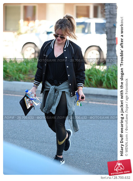 Купить «Hilary Duff wearing a jacket with the slogan 'Trouble' after a workout Featuring: Hilary Duff Where: Los Angeles, California, United States When: 28 Dec 2016 Credit: WENN.com», фото № 28700632, снято 28 декабря 2016 г. (c) age Fotostock / Фотобанк Лори