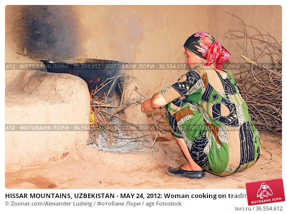 HISSAR MOUNTAINS, UZBEKISTAN - MAY 24, 2012: Woman cooking on traditional... Стоковое фото, фотограф Zoonar.com/Alexander Ludwig / age Fotostock / Фотобанк Лори