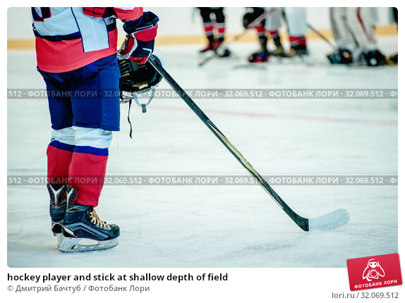 hockey player and stick at shallow depth of field. Стоковое фото, фотограф Дмитрий Бачтуб / Фотобанк Лори