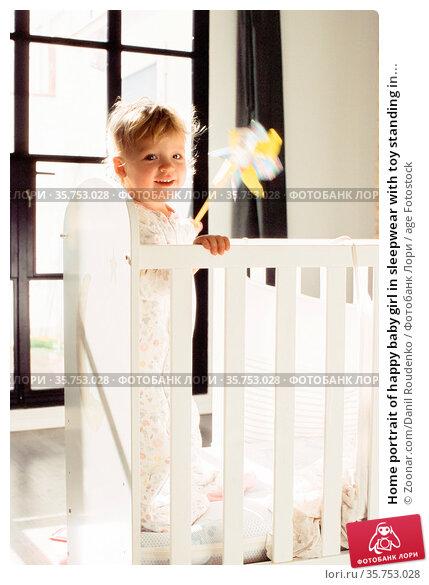 Home portrait of happy baby girl in sleepwear with toy standing in... Стоковое фото, фотограф Zoonar.com/Danil Roudenko / age Fotostock / Фотобанк Лори
