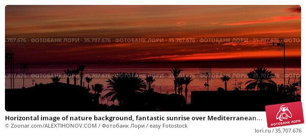 Horizontal image of nature background, fantastic sunrise over Mediterranean... Стоковое фото, фотограф Zoonar.com/ALEXTIHONOV.COM / easy Fotostock / Фотобанк Лори