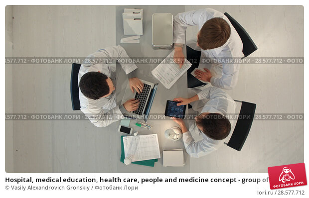 Купить «Hospital, medical education, health care, people and medicine concept - group of happy doctors with tablet pc computers meeting at medical office. Top view», фото № 28577712, снято 25 июня 2018 г. (c) Vasily Alexandrovich Gronskiy / Фотобанк Лори