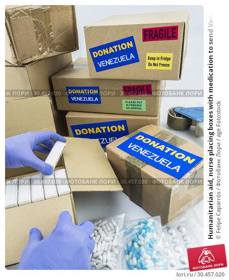Humanitarian aid, nurse placing boxes with medication to send Venezuela, conceptual image. Стоковое фото, фотограф Felipe Caparrós / age Fotostock / Фотобанк Лори