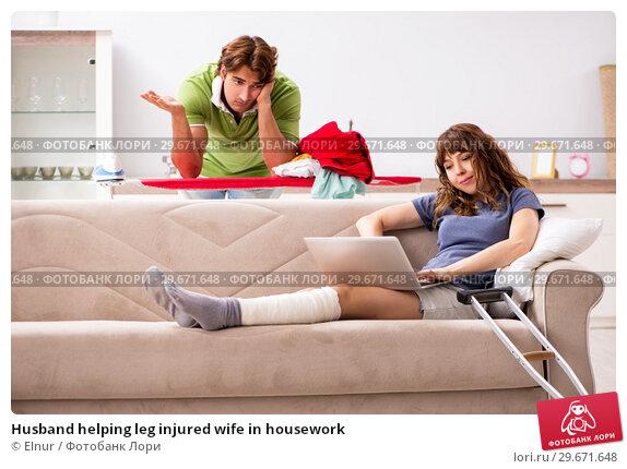 Купить «Husband helping leg injured wife in housework», фото № 29671648, снято 4 октября 2018 г. (c) Elnur / Фотобанк Лори