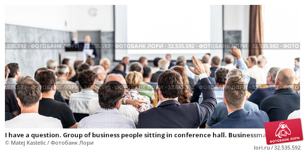Купить «I have a question. Group of business people sitting in conference hall. Businessman raising his arm. Conference and Presentation. Business and Entrepreneurship», фото № 32535592, снято 30 сентября 2019 г. (c) Matej Kastelic / Фотобанк Лори