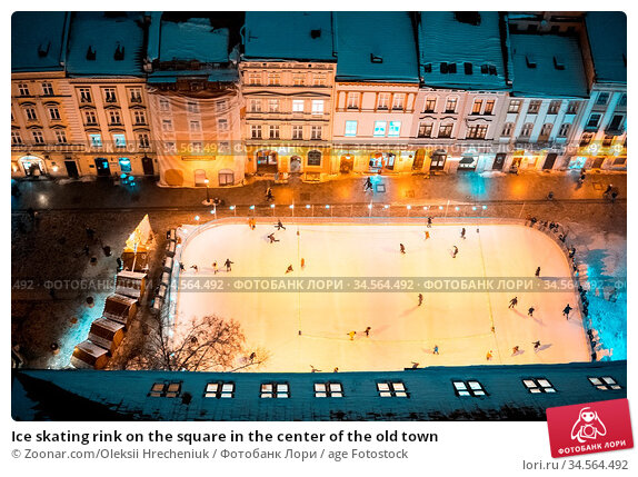 Ice skating rink on the square in the center of the old town. Стоковое фото, фотограф Zoonar.com/Oleksii Hrecheniuk / age Fotostock / Фотобанк Лори