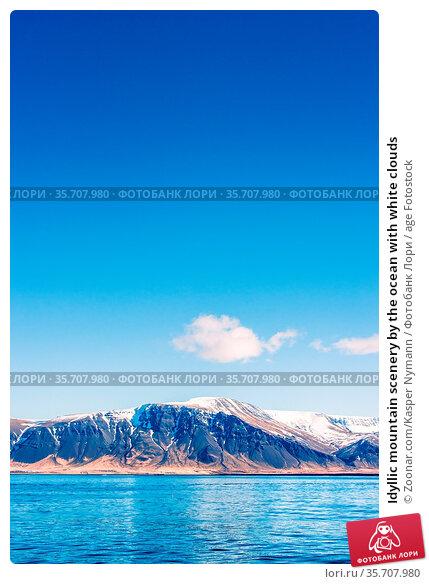 Idyllic mountain scenery by the ocean with white clouds. Стоковое фото, фотограф Zoonar.com/Kasper Nymann / age Fotostock / Фотобанк Лори