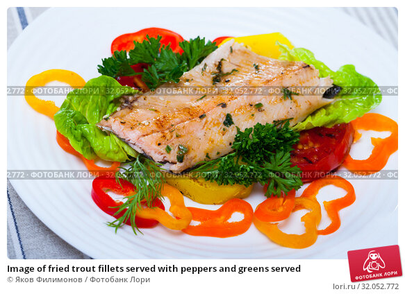 Image of fried trout fillets served with peppers and greens served. Стоковое фото, фотограф Яков Филимонов / Фотобанк Лори