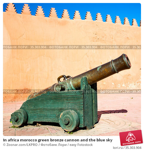 In africa morocco green bronze cannon and the blue sky. Стоковое фото, фотограф Zoonar.com/LKPRO / easy Fotostock / Фотобанк Лори