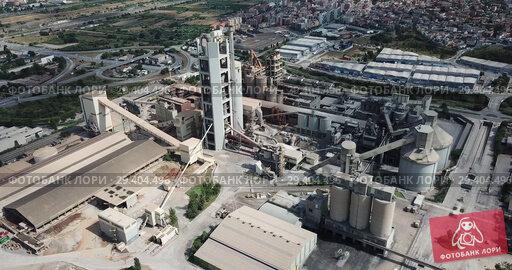 Купить «Industrial background with large cement factory. Aerial view», видеоролик № 29404496, снято 29 июля 2018 г. (c) Яков Филимонов / Фотобанк Лори