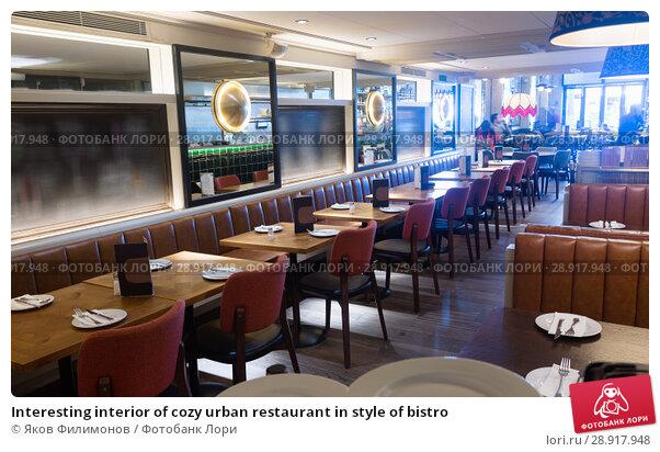 Купить «Interesting interior of cozy urban restaurant in style of bistro», фото № 28917948, снято 7 марта 2018 г. (c) Яков Филимонов / Фотобанк Лори