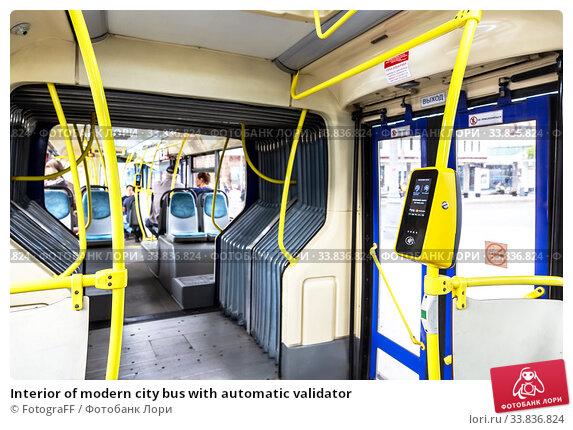 Купить «Interior of modern city bus with automatic validator», фото № 33836824, снято 7 июля 2019 г. (c) FotograFF / Фотобанк Лори