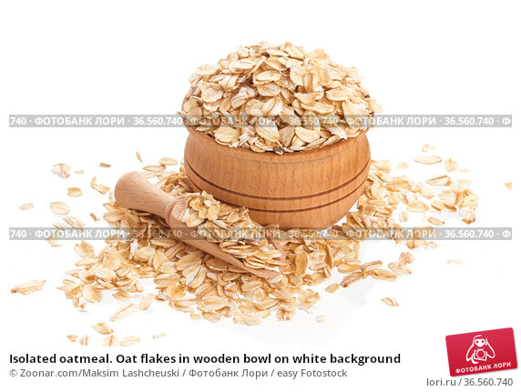 Isolated oatmeal. Oat flakes in wooden bowl on white background. Стоковое фото, фотограф Zoonar.com/Maksim Lashcheuski / easy Fotostock / Фотобанк Лори