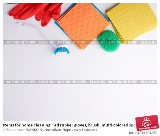 Items for home cleaning: red rubber gloves, brush, multi-colored sponges... Стоковое фото, фотограф Zoonar.com/DANKO N / easy Fotostock / Фотобанк Лори