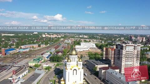 Ivanovo, Ivanovo Region, Russia - 06/08/2020: Golden domes of the Ascension Church on Station Square in the sun. Стоковое видео, видеограф Валерий Смирнов / Фотобанк Лори
