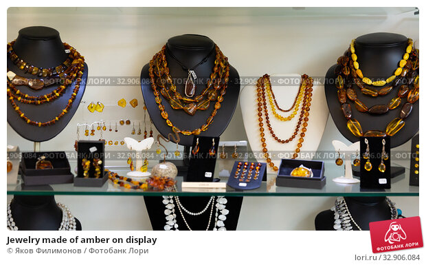Jewelry made of amber on display. Стоковое фото, фотограф Яков Филимонов / Фотобанк Лори