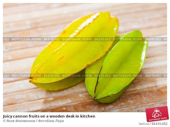 Juicy cannon fruits on a wooden desk in kitchen. Стоковое фото, фотограф Яков Филимонов / Фотобанк Лори