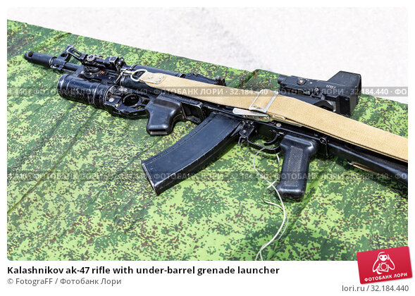 Купить «Kalashnikov ak-47 rifle with under-barrel grenade launcher», фото № 32184440, снято 18 мая 2019 г. (c) FotograFF / Фотобанк Лори