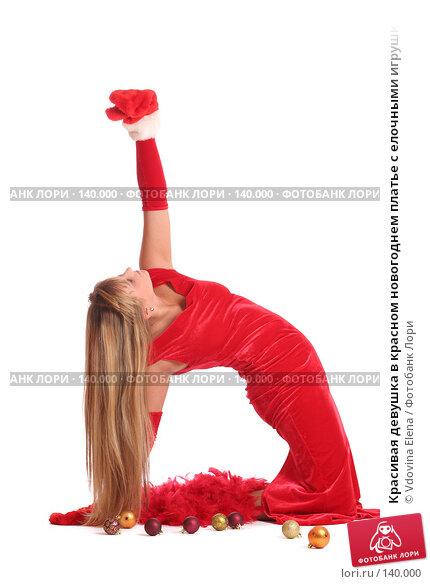 Купить «Красивая девушка в красном новогоднем платье с елочными игрушками на белом фоне», фото № 140000, снято 15 ноября 2007 г. (c) Vdovina Elena / Фотобанк Лори