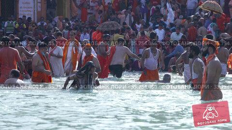 Kumbh Mela Haridwar India. Slowmotion shot of Sadhus or Saints of Akharas taking bath in Holy Water of River Ganges. Appleprores 422 Cinetone. Редакционное видео, видеограф Devendra Rawat / Фотобанк Лори