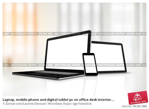Laptop, mobile phone and digital tablet pc on office desk interior... Стоковое фото, фотограф Zoonar.com/Laurent Davoust / age Fotostock / Фотобанк Лори