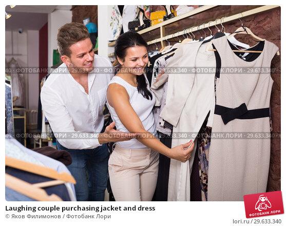 Купить «Laughing couple purchasing jacket and dress», фото № 29633340, снято 24 октября 2016 г. (c) Яков Филимонов / Фотобанк Лори