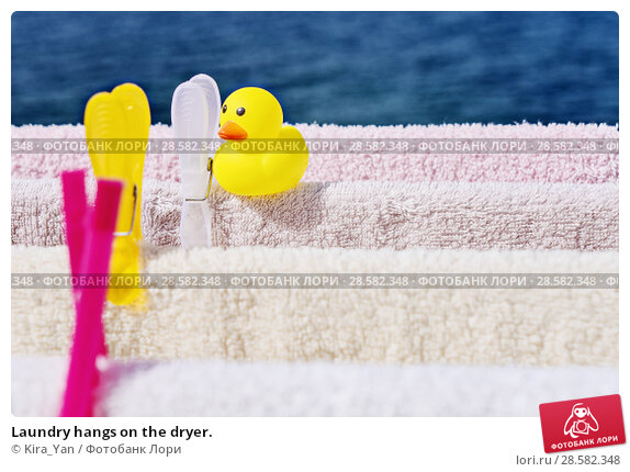 Купить «Laundry hangs on the dryer.», фото № 28582348, снято 12 июня 2018 г. (c) Kira_Yan / Фотобанк Лори