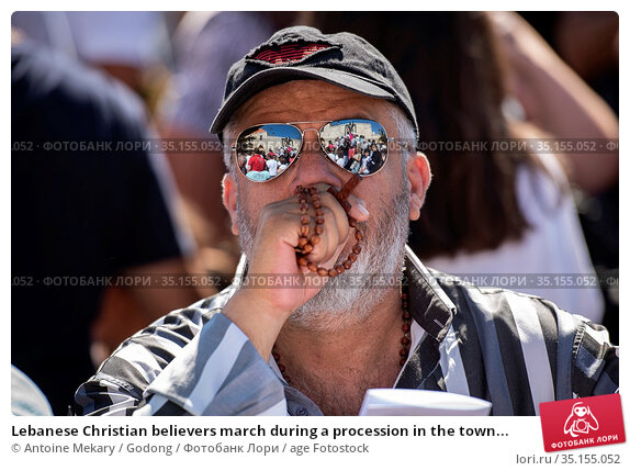 Lebanese Christian believers march during a procession in the town... Стоковое фото, фотограф Antoine Mekary / Godong / age Fotostock / Фотобанк Лори