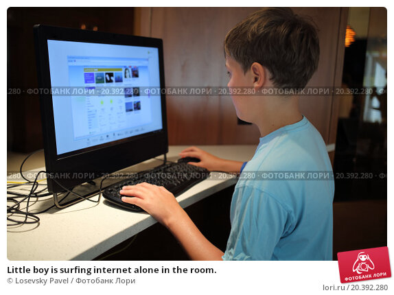 Купить «Little boy is surfing internet alone in the room.», фото № 20392280, снято 5 сентября 2014 г. (c) Losevsky Pavel / Фотобанк Лори