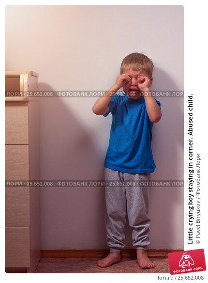 Little crying boy staying in corner. Abused child. Стоковое фото, фотограф Pavel Biryukov / Фотобанк Лори