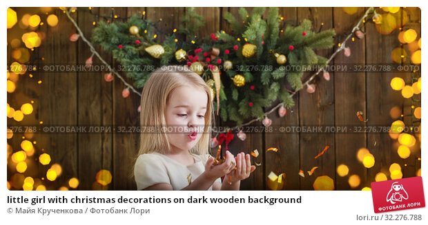 Купить «little girl with christmas decorations on dark wooden background», фото № 32276788, снято 17 декабря 2018 г. (c) Майя Крученкова / Фотобанк Лори