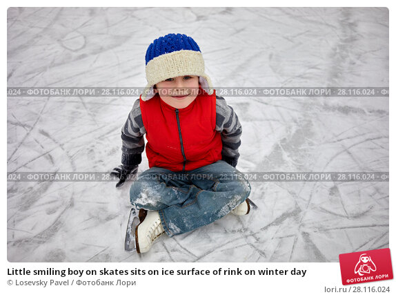 Купить «Little smiling boy on skates sits on ice surface of rink on winter day», фото № 28116024, снято 4 февраля 2017 г. (c) Losevsky Pavel / Фотобанк Лори