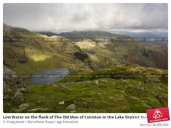 Low Water on the flank of The Old Man of Coniston in the Lake District National Park, Cumbria, England. Стоковое фото, фотограф Craig Joiner / age Fotostock / Фотобанк Лори