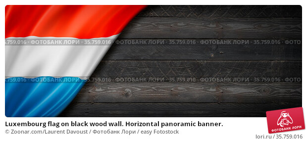 Luxembourg flag on black wood wall. Horizontal panoramic banner. Стоковое фото, фотограф Zoonar.com/Laurent Davoust / easy Fotostock / Фотобанк Лори