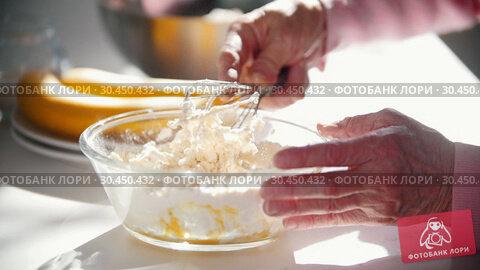Making pancakes. A hands of old woman mixes the ingredients. Стоковое видео, видеограф Константин Шишкин / Фотобанк Лори
