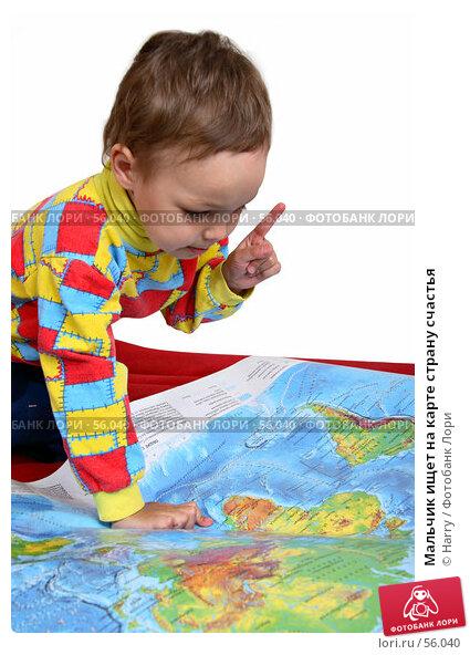Мальчик ищет на карте страну счастья, фото № 56040, снято 4 июня 2007 г. (c) Harry / Фотобанк Лори