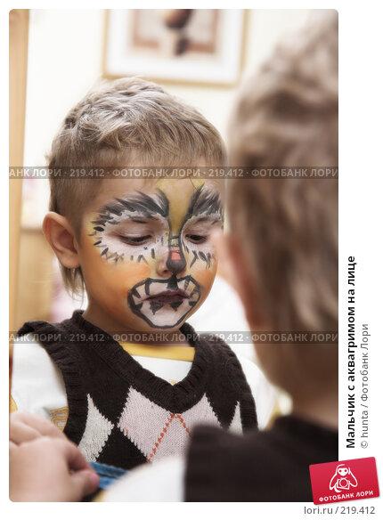 Мальчик с аквагримом на лице, фото № 219412, снято 1 января 2008 г. (c) hunta / Фотобанк Лори