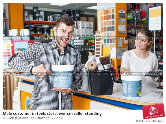 Купить «Male customer in tools store, woman seller standing», фото № 30487620, снято 17 мая 2018 г. (c) Яков Филимонов / Фотобанк Лори