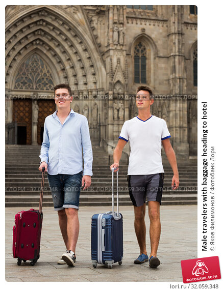 Male travelers with baggage heading to hotel. Стоковое фото, фотограф Яков Филимонов / Фотобанк Лори