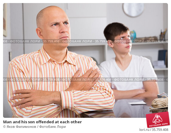 Man and his son offended at each other. Стоковое фото, фотограф Яков Филимонов / Фотобанк Лори