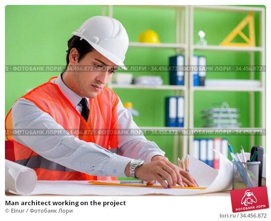 Man architect working on the project. Стоковое фото, фотограф Elnur / Фотобанк Лори