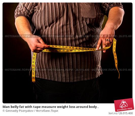 Купить «Man belly fat with tape measure weight loss around body .», фото № 26015400, снято 24 марта 2017 г. (c) Gennadiy Poznyakov / Фотобанк Лори